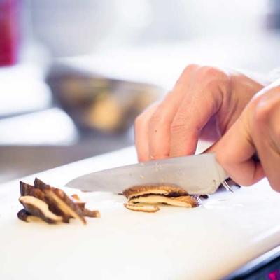 Kitchen image of RAKKAN RAMEN, Cutting shiitake mushroom