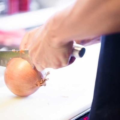 Kitchen image of RAKKAN RAMEN, Cutting onion