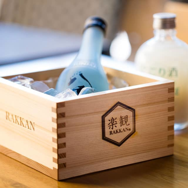 "Food image of RAKKAN RAMEN, ""Masu (Japanese measuring container)"" and sake"