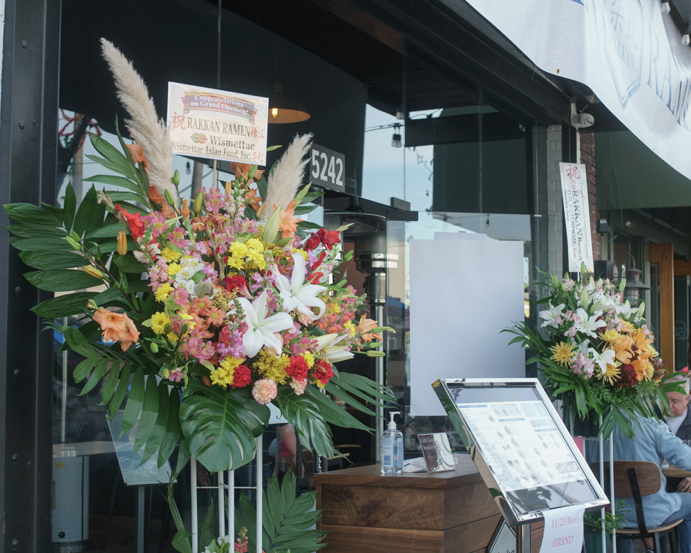 Long Beach Opening: Flowers at the entrance
